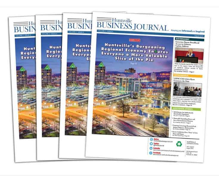 four issues of Huntsville business journal stacked